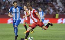 La ambición del Girona le otorga un triunfo histórico ante un gris Málaga