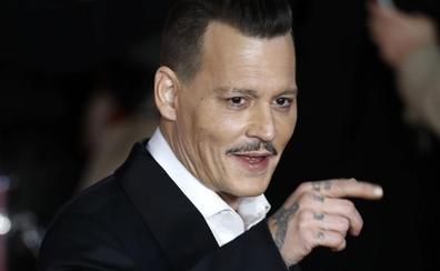 Johnny Depp cambia el significado de los tatuajes dedicados a sus ex
