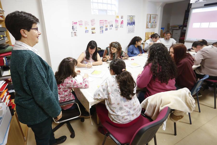 Los voluntarios y usuarios del centro